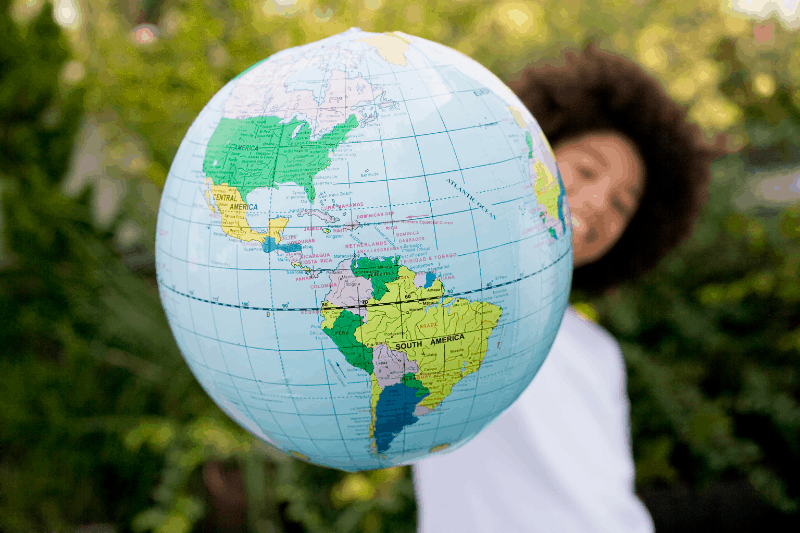 Young girl holding a globe - visual representation of a biblical worldview